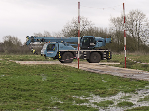 3.5 ton crane on Dura-Base mats over marshy ground